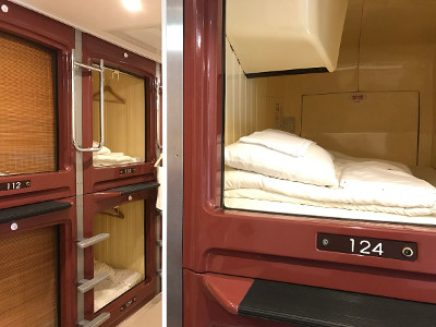 Capsule hotel with small numbered compartments one above another with steps to top units