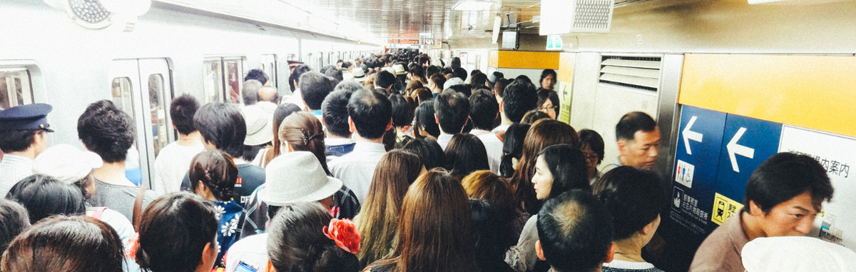 Very crowded subway platform with too many people