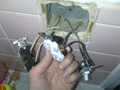 Exposed bathroom power outlet wiring