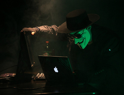 Masked hacker on a laptop