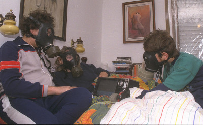simple solutions stop air pollution at home - family in gas masks in bedroom