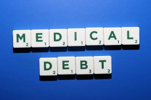 Medical debt - spelled out in scrabble game pieces