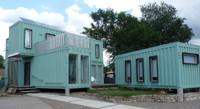 Home complex made of 3 shipping containers painted light blue