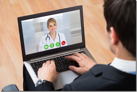 Telehealth review, a man has doctor visit session on a laptop