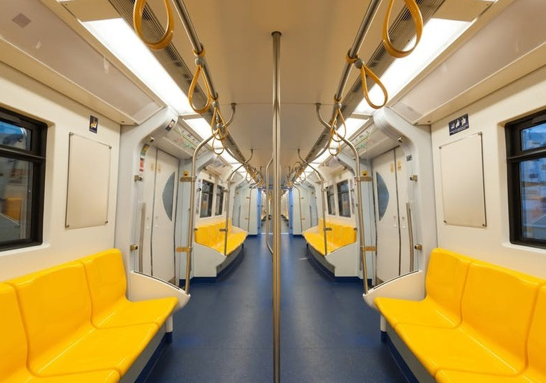 Empty subway interior with yellow seats